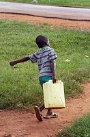 UGANDA  Boy carrying jerry can,  Village of Kabembe, Mukono District