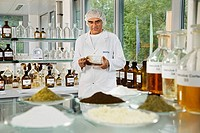 A worker of a company producing natural remedies is potentiating or diluting liquids according to a set rhythm in a lab for potentiation, Arlesheim, S...