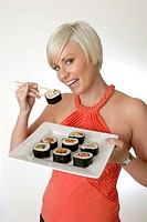 Woman, young, blond, portrait, eating, Fingerfood, food, fish, sushi, enjoying, delicious, sticks, Japanese, Asian, Ad