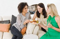 A woman offering friends canapes