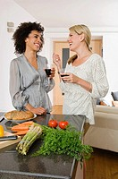 Two women having red wine