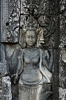 Stone carving of a female face, Apsara, celestial nymphs, Bayon Temple, Angkor Wat, Siem Reap, Cambodia
