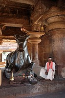 Guardening the sacred bull Nandi in a temple dedicated to Shiva, at the ancient site of Pattadakal, Karnataka, India