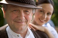Mature man with young woman in beergarden near Lake Starnberg, Bavaria, Germany