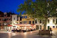 People sitting outside a restaurant bar, Campo Santa Margherita, Venice, Veneto, Italy