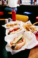 Three Hot Dogs and French fries in the Restaurant, Chicago, Illinois, USA, Chicago, Illinois, USA