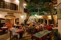 Life in the city, people sitting outside Rimi Restaurant at night enjoying an evening meal, Laiki Geitonia, Lefkosia, Nicosia, Cyprus