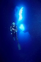 A diver in an underwater cave Palau Micronesia.