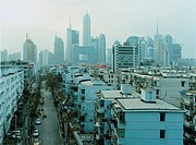 View of the city, financial district with skyscrapers. Apartment buildings in the foreground, Urbanisation, Pudong, Shanghai, China