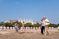 People walking along the beach, Hotel des Bains, Lido, Venice, Laguna, Veneto, Italy