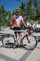 Cyclist at Esporles Plaza, Esporles, Mallorca, Balearic Islands, Spain