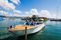 Water guards in a boat near Seerose restaurant, Lake Zurich, Zurich, Switzerland