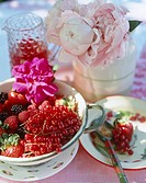 Summer berries of raspberries, red currants and strawberries in a bowl