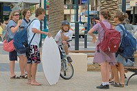 Teenagers with surf board, Glenelg, Adelaide, South Australia, Australia