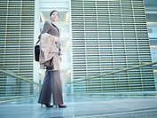 Businesswoman standing in building atrium