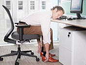 Businessman sleeping on computer keyboard