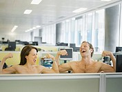 Naked businesspeople flexing muscles in office