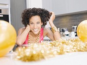 Woman in kitchen with Christmas party decorations