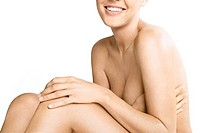 Nude woman covering her breasts (thumbnail)
