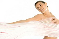 Nude woman with sheer scarf covering breasts