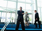 Confident businessman posing in lobby