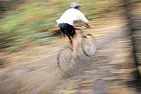 Mountain biker going through a mud puddle