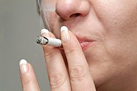 Close up of a woman smoking a cigarette