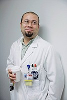 Hispanic doctor on coffee break