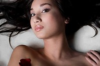 Portrait of a young woman lying on a massage table