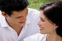 Close_up of a young couple looking at each other and smiling