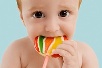 Portrait of a boy licking a lollipop (thumbnail)