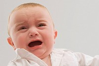 Close_up of a baby boy crying