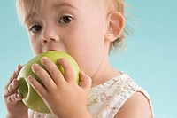 Portrait of a girl eating an apple (thumbnail)