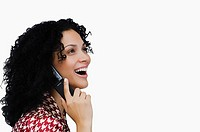 Side profile of a businesswoman using a mobile phone