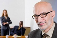 Portrait of a businessman with his colleagues in the background (thumbnail)