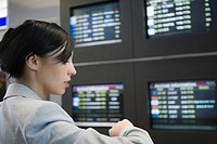 Close_up of a businesswoman checking the time at an airport