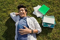 High angle view of a young man lying in a lawn (thumbnail)