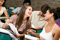 University students sitting in a classroom and smiling