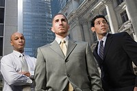 Low angle view of three businessmen standing