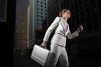 Low angle view of a businesswoman carrying a briefcase