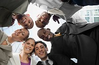 Low angle view of business executives standing in a huddle (thumbnail)