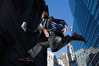 Low angle view of a businessman running in mid_air