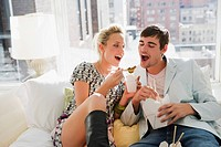 Young couple eating food with chopsticks (thumbnail)