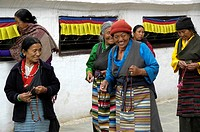 Tibetan women wearing traditional dress at Bodhnath Stupa Kathmandu Nepal