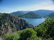 The Cevennes Dam, with the Lac de Villefort and hills in the background, in Lozere, Languedoc Roussillon, France, Europe