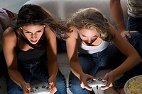 High angle view of two young women playing video game