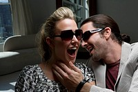 Young couple laughing (thumbnail)