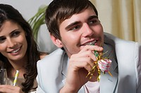 Close_up of a young couple enjoying a birthday party
