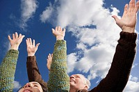Close_up of a couple with their arms raised