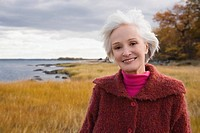 Portrait of a senior woman smiling on the beach